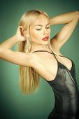 Sexy Woman. Glamour Lifestyle Concept. Girl With Long Blond Hair On Green Background. Erotic And Sed poster