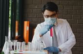 Medicals Or Scientific Laboratory Researcher Performs Tests With Red Liquid In Lab. Laboratory Equip poster