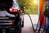Pumping Gasoline Fuel In Car At Gas Station,travel,transportation And Holiday Concept. poster