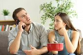 Desperate Couple Callling To Insurance Worried About Home Leaks In The Living Room poster