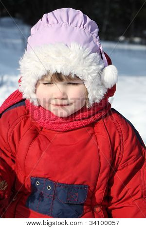 Little Beautiful Girl Wearing Warm Clothing Walks In Winter Forest