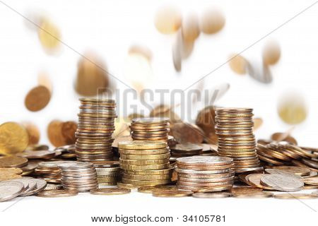 Stacks Of Silver And Golden Coins And Falling Coins On Background Isolated