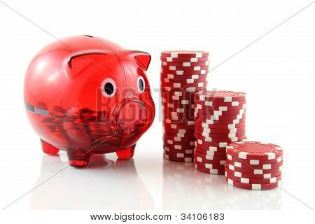 poker chips with a piggy bank on a white background