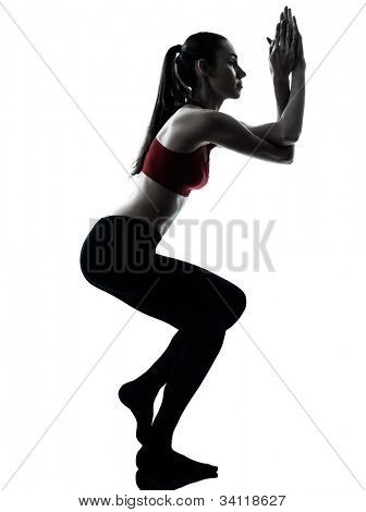 one caucasian woman exercising Garudasana eagle pose in silhouette studio isolated on white background