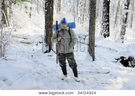 Persons In Wood In Winter