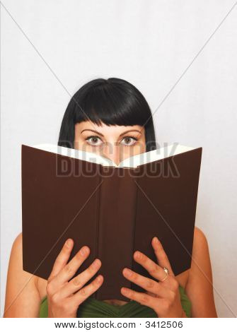 Young Woman Reading A Book.