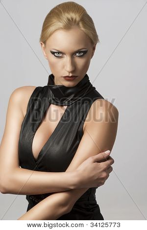 Beautiful Woman In Sexy Dress With Hand On The Arm