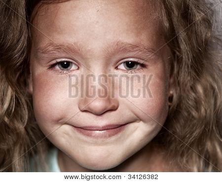 Crying child. Sad little girl portrait closeup