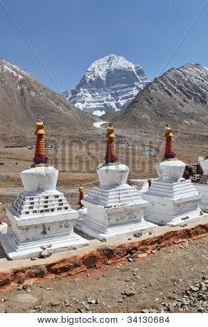 Buddhistic stupas (chorten) in Tibet and holy Mount Kailash on background