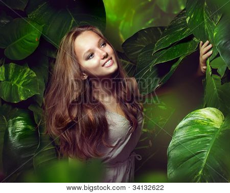 Beautiful Girl in Green Mystical Forest.Tropic
