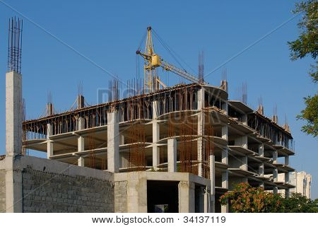 incomplete construction with crane