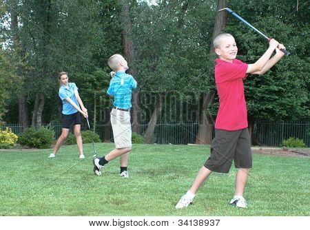 Three Young golfers - family fun