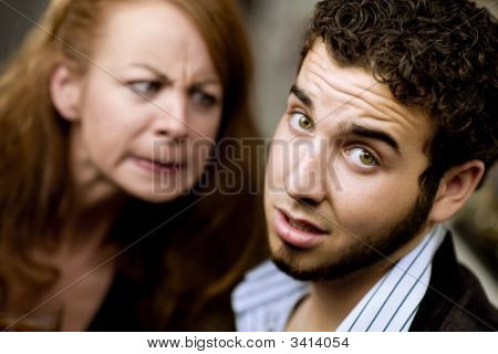 Angry Woman Looks At A Man
