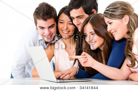Group of friends with a laptop computer - isolated over white backgorund