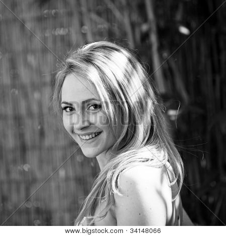 Pretty Girl Smiling In Black An White