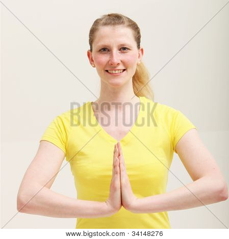Woman With Her Hands Together In A Yoga Pose