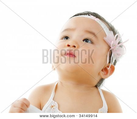 Curious asian baby girl looking up, isolated on white background