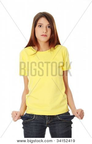 Young beautiful woman with surprised face is showing empty pockets.  Isolated on the white background.