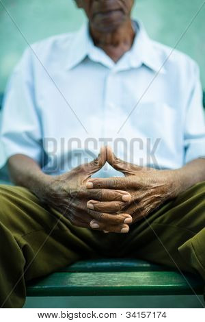 Pensive Old Man Sitting On Bench In Park