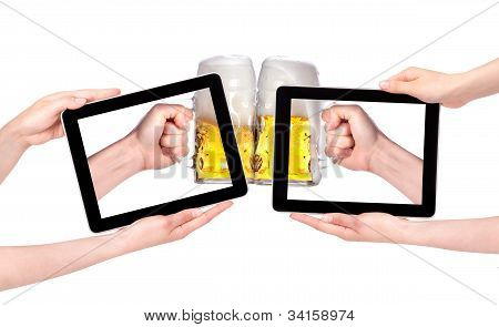 Isolated Hands Holding Digital Tablet With Beers Making A Toast