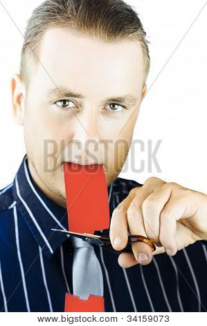 Business Person Cutting The Red Tape