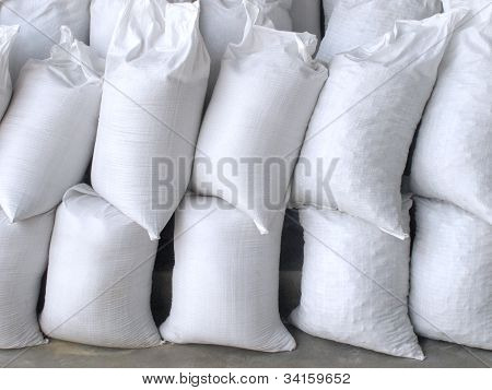 White Sacks Full With Sand And Rock