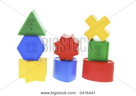 Stacks Of Shape Sorter Toy Blocks