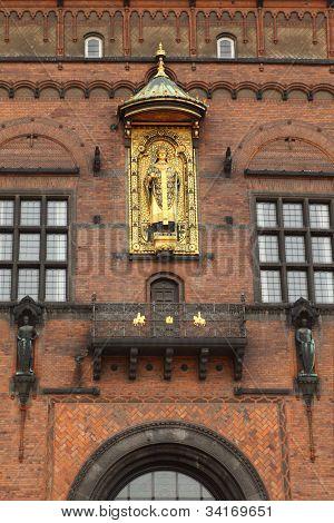 Detail of facade of Copenhagen City Hall in Copenhagen, Denmark. Sculpture of priest.