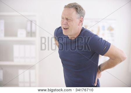 Man suffering from backache at office