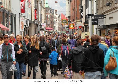 COPENHAGEN  - JULE 23: People walk down Stroget street on Jule 23, 2011 in Copenhagen, Denmark. Stroget - longest pedestrian street in world.