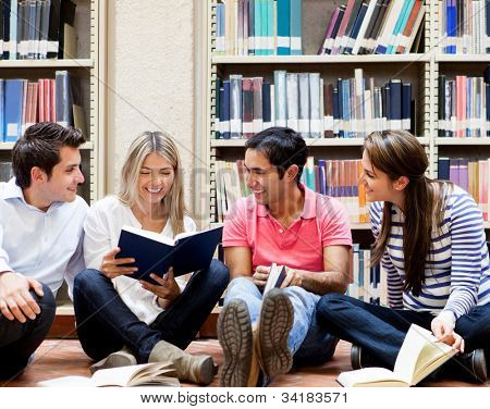 Group of college students at the library looking happy