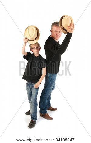 Sturdy father and son with hats making performance