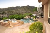 stock photo of ocotillo  - An awesome resort type backyard on the side of the mountain with a negative edge pool  - JPG