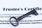 pic of skeleton key  - Vintage key in a trust fund document abstract - JPG
