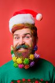 Bearded Man In Santa Hat With Decorated Beard For New Year. Santa Claus Man With Decorated Beard. Me poster