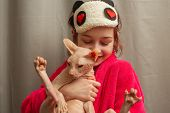 Picture Of Adorable Young Caucasian Female Hugging Her Cute Highbred Pet. Sphynx Cat With No Fur Pur poster