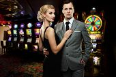 stock photo of mafia  - Retro couple against slot machines - JPG