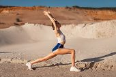 Young Woman Stretching Legs And Warming Up At The Nature. Attractive Girl Stretching Before Fitness. poster