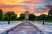 City Palace In Jaipur Taken From Govind Dev Temple With A Dramatic Sunset In The Sky poster