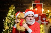 Santa Claus Man With Teddy Bear On Shoulders. Happy Santa Claus With Teddy Bear. Christmas Decoratio poster