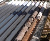 Core Samples From The Well. Core Drilling For Sampling Of Geological Rock. poster