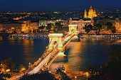 Panoramic Night View Of Budapest. Illuminated Chain Bridge Reflected In Danube River. Illuminated Me poster