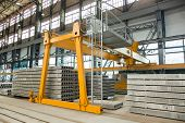 Automated Equipment For The Production Line For The Production Of Hollow Floor Slabs, An Overhead Cr poster