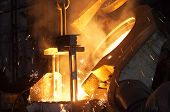 stock photo of ironworker  - manufacturing process in a metal foundry in Gliwice - JPG