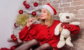 Alone At Home. Lonely Woman With Teddy Bear Toy And Champagne Glass Christmas Eve. Nostalgic Moments poster