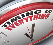pic of punctuality  - The words Timing is Everything on a clock to illustrate the importance of being on time - JPG