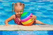 Happy Family In Swimming Pool. Smiling Child Swim, Dive In Pool With Fun, Play Active Games With Bal poster