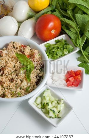 Refreshing tabouleh salad surrounded by healthy ingredients