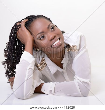 Beautiful young african woman dreaming and looking right into the corner