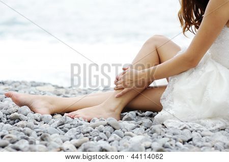 Bride Sitting By The Sea